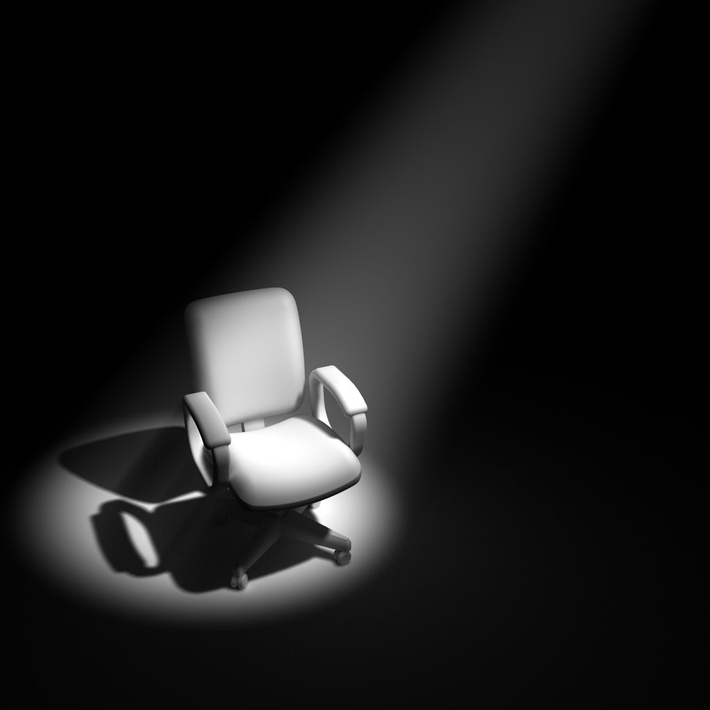 3d render of an office chair in a spotlight